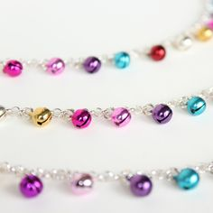 Available in gold or silver,these multi coloured bell anklets are the perfect first birthday gift for little girls!