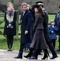 Kate wearing a Michael Kors suit and Aquatalia boots