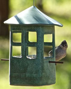 Features: Pottery Bird Feeder Steel Cable Natural Twig Measures 4 x 4 x 8 We. Hand Built Pottery, Slab Pottery, Ceramic Pottery, Pottery Art, Pottery Studio, Pottery Painting, Ceramic Houses, Ceramic Birds, Pottery Houses
