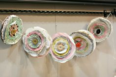 Garland of paper flowers. Cute! I could use up some of scrapbook paper stash!