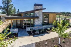 Modern Style House Plan - 3 Beds 2.00 Baths 1731 Sq/Ft Plan #895-60 Exterior - Front Elevation - Houseplans.com