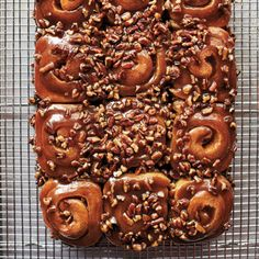 """Schnecken, which means """"snails"""" in German, are basically pecan-cinnamon buns. Once the schnecken are turned out hot from the pan, the top of the buns are covered with gooey pecan caramel. Make into mini buns? Churros, Sticky Buns, Cinnamon Rolls, Pecan Rolls, Cinnamon Recipes, Nut Recipes, Chef Recipes, Recipies, Bakery"""