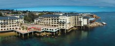 Monterey Plaza Hotel and Spa adds new meaning to the phrase waterfront lodging. You're not near the water, or even next to the water.