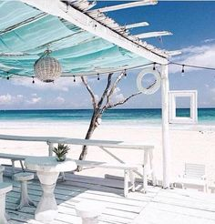 Love the white wash, the viewing frame.  Could paint the inside walls of the deck to match the beach, surf, ocean layers.  The blue fabric roof drapes would give the illusion of sky.