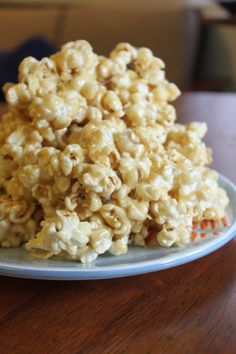 Caramel Fluff Popcorn - Recipe- just made this and it is super easy and YUMMY!!! I suggest not using the corn syrup (because your marshmallows probably already have them in it) and adding some salt onto it when it is all done!! Eat up!