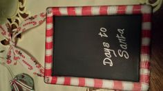 a small chalkboard paint with a candy cane border