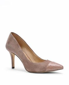 "Step up your style game with this sumptuous suede pair, capped with an exotically textured pointy toe for an impossibly sleek finish. Pointy toe. Padded footbed for complete comfort. Covered 3"" heel."