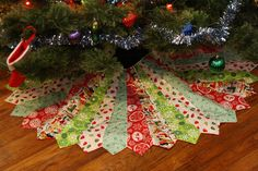 necktie tree skirt- when I have a house and  room for a real normal sized tree, this is happening