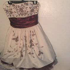 Price DropCream brown dress w/ sequin flower Price Drop️Gorgeous fashion forward dress with rich colors like cream, brown, and silver sequin detail. Sweetheart style great design. Morgan & Co. Dresses