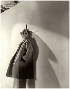 A model wears round sunglasses, polo Model wearing a wool coat and mustard felt hat, both by Molyneux 1936 Photo Cecil Beaton