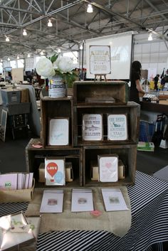 vendor booth idea: Wood crates are a great way to create vertical displays in a small space Craft Stall Display, Craft Booth Displays, Display Ideas, Booth Ideas, Vendor Table, Vendor Booth, Craft Fair Table, Stand Feria, Vendor Displays