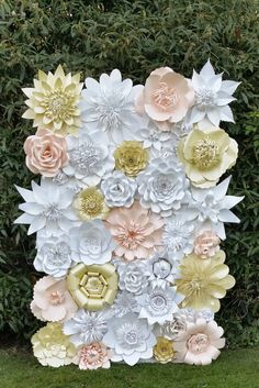 This 6ftx4ft handcrafted backdrop is made of various sized paper flowers. A perfect for any occasions.This backdrop can be made in any sizes and colours combination. The listing does not include a backdrop or wall - flowers will come fully assembled and ready to install onto your surface. Please contact me if you need different colour or size, also flowers available for rent convo me for more details.   You can see my work on: https://m.facebook.com/weddingpaperflowerdesign…