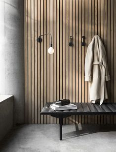 The Small Afteroom Coat Hanger by Menu goes to show that sometimes less is more. A minimalist and versatile design, this coat hanger has two distinct dots of differing sizes from which you can hang your coat, umbrella, or whatever else you can think of. Wood Slat Wall, Wood Slats, Concrete Wall, Interior Desing, Interior Architecture, Spa Interior, Japanese Interior Design, Modern Architecture House, Futuristic Architecture