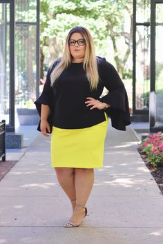 Ever wonder what you should wear in the office? Eloquii's elbow flounce top and yellow neoprene skirt make for the perfect work outfit. See more plus size office outfits on Natalie in the City.