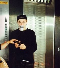 """24 Times Leonardo DiCaprio Was A Total Badass"" When his teeth were ballin' and held up this cup."