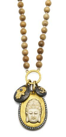 Sara Weinstock Pendant in oxidized silver and 18k gold has a carved Mammoth Tusk Buddha Head and a Maltese cross on Mammoth Tusk beads with 1.3 cts. t.w. champagne diamonds; $14,060 #SaraWeinstock #gold #Buddha #champagnediamonds