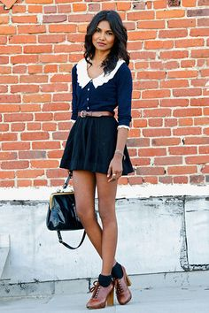 Collared top, skater skirt, ankle heels.