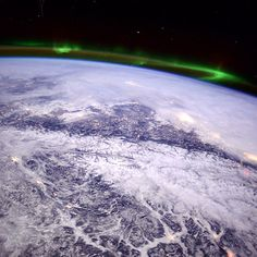Mountains over Montana, aurora to the north. --Astronaut Butch Wilmore from the International Space Station.