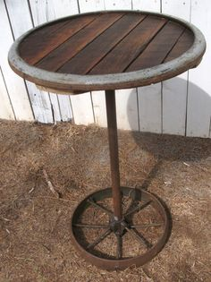 Cool Repurposed Rustic Beautiful Sawmill Wooden Table with antique wheel base and neat rim design. $85.00, via Etsy.
