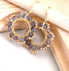 Elegant hoop earrings with hand twisted gold wire and lavender Czech glass.