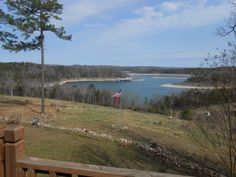 Wide Open Lake view from this custom built cedar home with full finished basement, loft, geo thermal heat & air, and wrap around deck. 40x40 garage, shop with 14' overhead door for RV, and city water. All on 5 Acres. Joins government strip. Path to Lake!! in Jordan AR