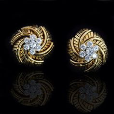 Striking earrings designed as clusters of brilliant-cut diamonds, set in a pierced yellow gold mount of stylised fern leaf design by Cartier, Paris c1950s. Hancocks & Co (Jewellers) Ltd. www.hancocks-london.com