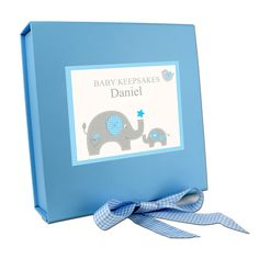 This adorable Blue Gift Box is Ideal for presenting the rest of the Blue Baby Elephant Range!  Personalise with 1 line of text up to 12 characters.  'Baby Keepsakes' is fixed text.  The pink and blue gift boxes measure 220 x 225 x 65mm and feature a gingham ribbon. The box is kept shut with a magnet close.  Please note our gift boxes are only suitable for our own products.  NOTE: Due to the font type used please refrain from using all capitals in your personalised message. If the message is…