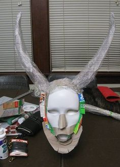 Krampus' face had humble beginnings as a plastic mime mask, cereal box cardboard, and fine wire mesh.