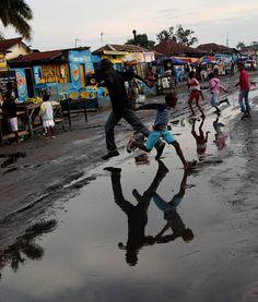 Jumping puddles in Kinshasa