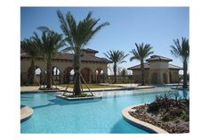 Stately palm trees frame the Community Pool. The master-planned new home community Mar Bella, near Houston.