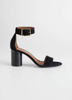 324586299fb Suede strappy heeled sandals detailed with a square outer buckle and a  cylindrical block heel.