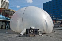 Raumlabor [DE] - BXL | The BXL by Raumlabor is a bicycle that has a big inflatable space coming out of the sides. It interacts with the architectural and social space and opens up urban space for temporary collective uses. The membrane of the bubble is translucent so people on the inside can see what´s going on outside and vice versa. | Photo: Michael Danker