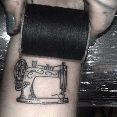 """""""this tiny sewing machine is the size of a spool of thread!"""""""