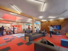 Mobile gaming company Pocket Gems has a new and colorful space located in San Francisco which was designed by Min   Day. The office is located within the city's financial district, arranged in an open plan style. Taking advantage of large, existing skylights and an exposed wood structure, this 7,000 sqft commercial interior for a mobile game developer combines a fun and flexible office environment with casual spaces for play, relaxation and work.