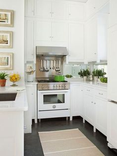 Mod Vintage Life: Vintage Kitchens - love the high ceilings and white cupboards