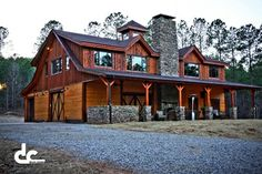 This custom barn with living quarters in Newnan, Georgia has a full loft living quarters, two 60' shed dormers.  The main level consists of two stalls, a tack room, wash bay, garage, custom stainless steel processing room with a commercial style kitchen, and two full length shed roofs, one being fully enclosed for additional living space. The loft living quarters consists of a master suite, and additional bedroom, bathroom, laundry room, all completed with custom timber framed ceiling.