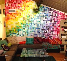 cats. comfty couch. pretty pillows. rainbow wall made of paint chips. this person should be my new best friend!