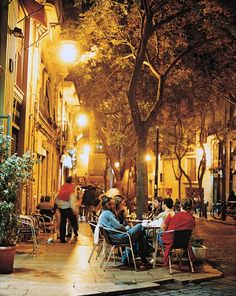 Hanging out on Valencia's Plaza Esparto. Tapas restaurants serving tasty inexpensive morsels like marinated anchovies abound in the city.