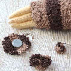 """Sew cute & sluggish looking sock sloth, Smie. It is 16"""" long sewn from chenille socks, with 3 claws on each limb, big groggy eyes & a sweet smile."""