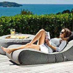 I would love to have this for my pool area. Cushioned Patio Furniture - The Outdoor Bean Bag Lounger Makes Backyard Lifestyles Much More Comfy (GALLERY) Outdoor Bean Bag, Outdoor Fun, Outdoor Spaces, Outdoor Living, Outdoor Decor, Bean Bag Lounger, Bean Bag Chair, Pool Furniture, Outdoor Furniture
