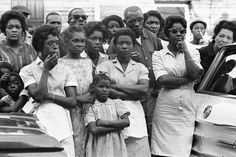 The bombing of the 16th Street Baptist Church in 1963 killed four young girls preparing to worship. In this image, mourners are shown attending funeral services for Carol Robertson, one of four girls killed.  Photo credit: AP