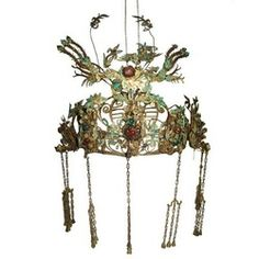 artdornment:  Qing Dynasty Chinese Provencial Kingfisher Headdress China 19th century Exceptional quality handmade kingfisher tiara or headdress used by a provencial Chinese leader dating to the 19th century. Rendered in hand wrought brass and metal, inlaid with iridescent turquoise kingfisher feathers. Cabochon glass jewels present as well.