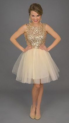 ShopBlueDoor.com: Nothing says party like tulle and gold sequins, making this a perfect party dress! $59