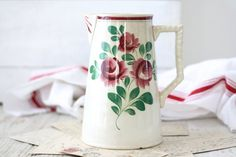 French vintage romantic pitcher with a very lovely drawings of roses.     Also ideal for a vase or for storing utensils in the kitchen.    The decor