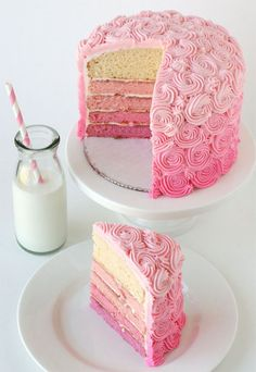oh my. love love love. graducated color frosting, that swirly rose thing and different colors inside the cake? bakers are like magicians. truly.