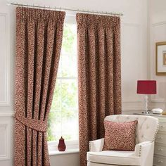 Decorated with a red trailing leaf print of a cream base, these lined pencil pleat curtains are available in a choice of sizes....