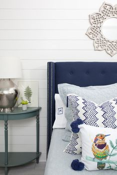 Interior Design: An Ode to Blue Using Blue in your home.  Love the mix of blues in this beautiful bedroom.  The blue tufted headboard with nail head trim from @potterybarn mixed with the blue side table and great printed pillows is such a gorgeous combination and really pops against that bright white ship lap wall.