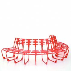 GHISA bench by Alias Design -- In lamellar cast iron lacquered for outdoor use.  This is an extremely flexible modular seating system designed for urban and residential communal outdoor spaces, Theoretically infinite and adaptable to any situation;  by combining modules with small back and large seat or large back and small seat it is possible to create semi-circular, circular or wave-shape compositions.