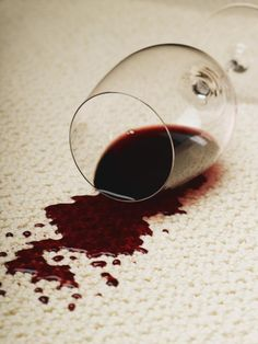 Effectively remove red wine spots from your carpet using common household ingredients, including salt, vinegar, and dishwashing detergent.
