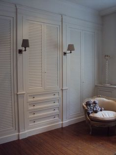 Wall of closets with sconces. Love these painted cabinets. I think they would also make great closet doors.